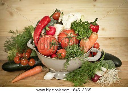 Fresh vegetables in metal colander