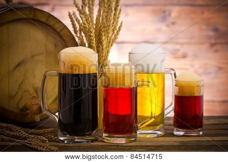 Beer barrel with beer glasses on a wooden table