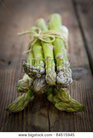 Fresh asparagus on the wooden table closeup