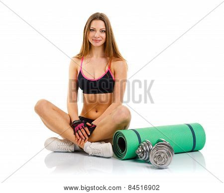 Beautiful Sport Woman With Dumbbells, Mat For Fitness, A Bottle Of Water Doing Sport Exercise