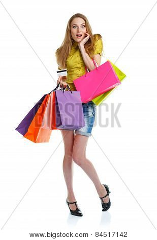 Happy Caucasian Woman With Shopping Bags And Holding Credit Card On White Background