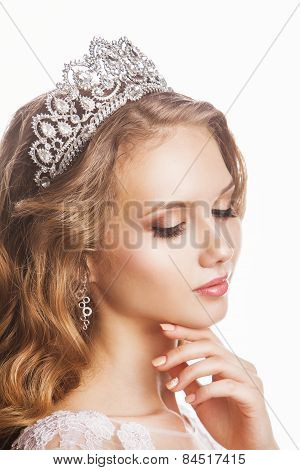 Portrait of beautiful young arrogant bride - isolated on white background