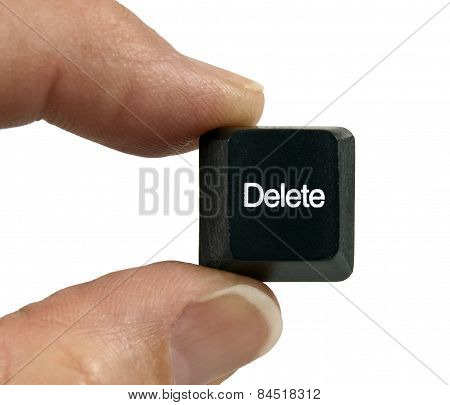Fingers Holding Black Delete Key From Computer