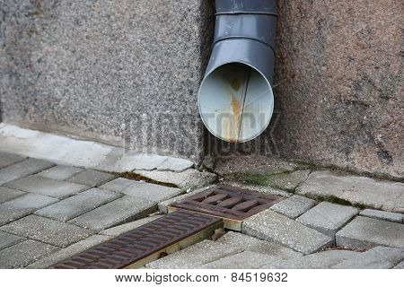Water Drain Near Wall On The Street