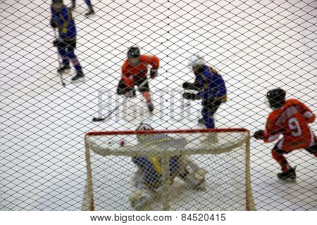 Atack Of Gate And Ice Hockey Goalkeeper