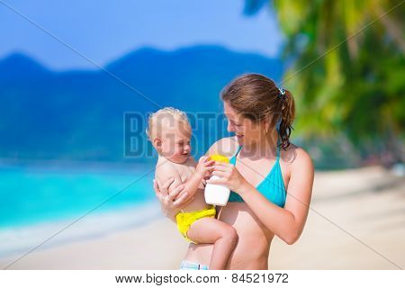 Mother And Baby At A Beach