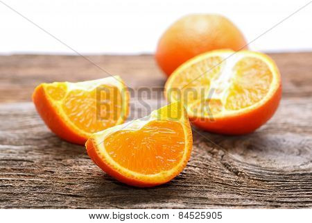 Tangerine slices on wooden table