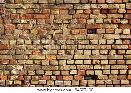 Striking brick wall