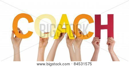Many People Hands Holding Colorful Straight Word Coach