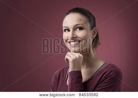 Smiling Woman With Hand On Chin