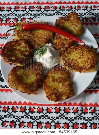 Potato Pancakes With Sour Cream On A Traditional Ukrainian Towel