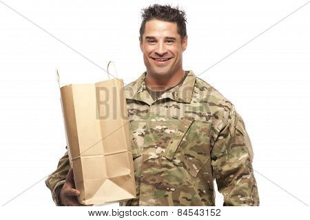 Happy Army Soldier With Shopping Bag