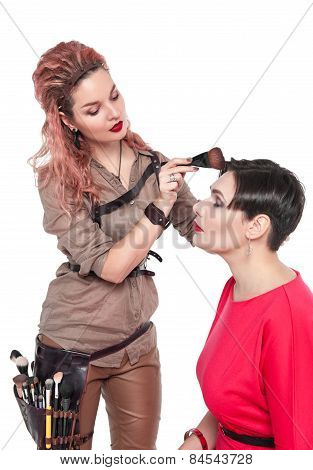 Professional Makeup Artist Making Makeup To A Model Isolated