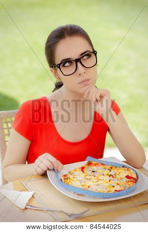 Thoughtful Woman Measures Pizza with Measure Tape