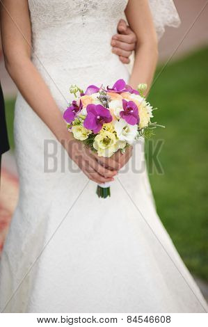 Bride holding a bouquet of beautiful flowers