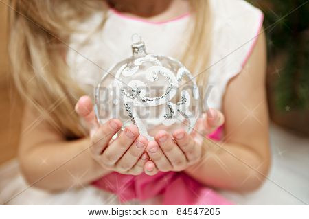 Child with Christmas toys in the hands of
