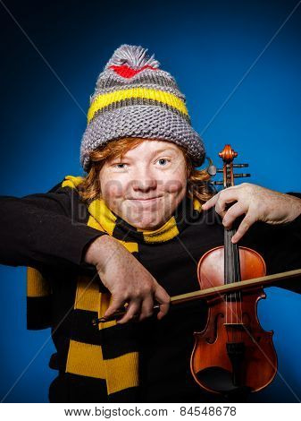 Red-haired Expressive Teenage Boy Playing Violin, Funny Concept
