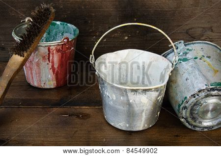 Paint cans or paint bucket on wooden background