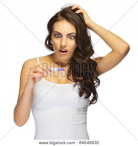 Young surprised girl with pregnancy test isolated