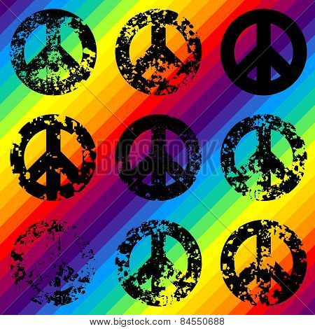 Grunge black signs of pacific on rainbow background.