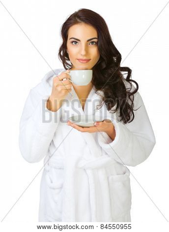Young girl in bathrobe with cup isolated