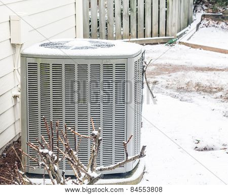 Air Conditioner Unit In The Snow