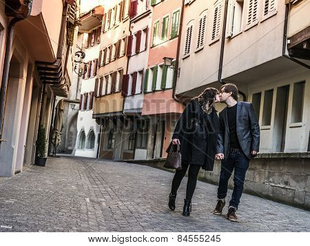 Couple Walking And Kissing In The City