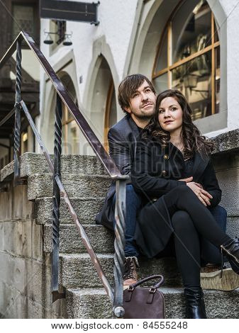 Couple Sitting And Resting In The City