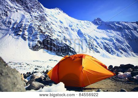 tent under a mountain