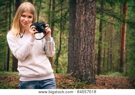 Young Woman with retro photo camera outdoor Travel Lifestyle