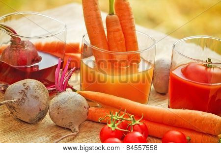 Carrot juice, tomato juice and beet juice