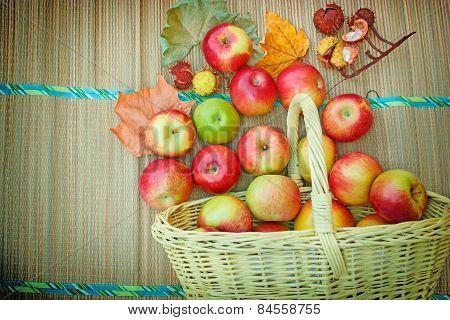 Autumn fruit in a wicker basket