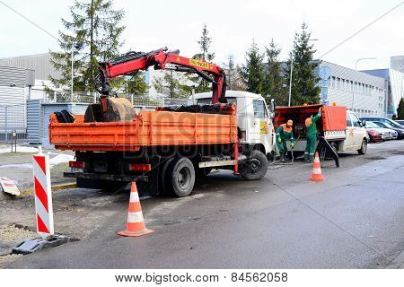 Workers Repairing Road In The Street Of Vilnius City
