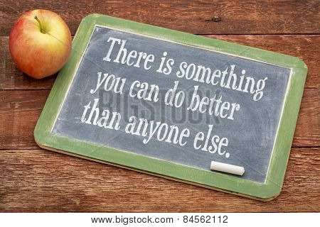 There is something you can do better than anyone else - positive words on a slate blackboard against red barn wood