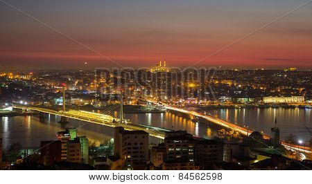 Golden horn of Istanbul at night with mosque skyline