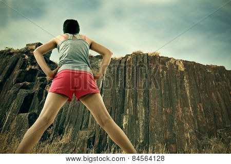 Girl getting ready for climbing on rocks