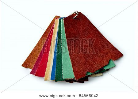 Scraps Of Colored Leather Fastened A Metal Bracket