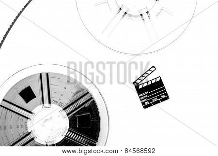 Vintage 8Mm Movie Reels And Small Clapper Board White Background