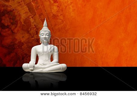 White buddha, isolated against colorful grunge background (incl. clipping path)