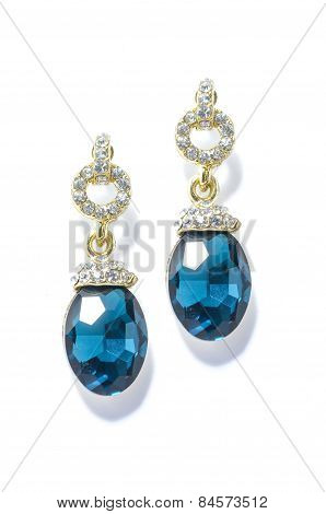 Earrings With Sapphire  On The White Background
