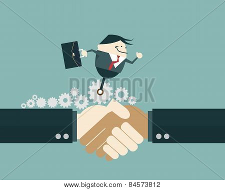 Business People Shaking Hands And Business Man  Ride On Gear Wheel