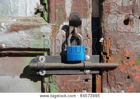 New blue lock on the old cracked door