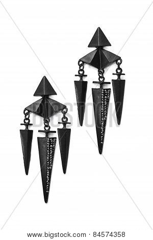 Black Earrings In The Shape Of Cones On A White Background