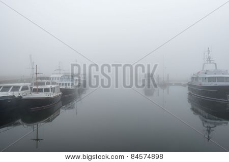 Motor Yachts Moored In A Dutch Marina
