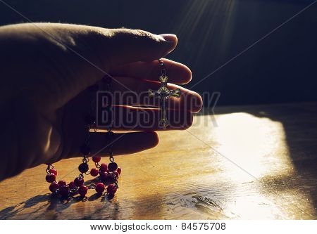 Hand holding rosary