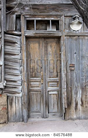 Obsolete wooden door of very old house in Astrakhan, Russia