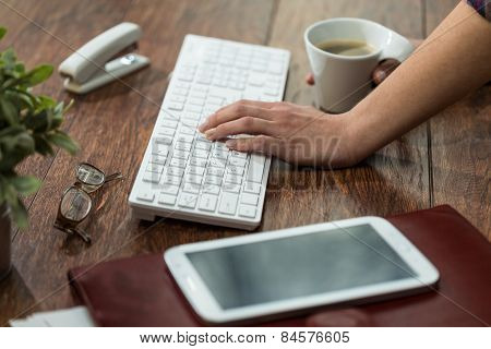 Female Typing On Keyboard