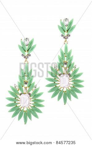 Green Earrings Inlaid With Precious Stones On A White Background