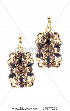 Gold Earrings Inlaid With  Gemstones On A White Background