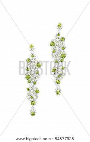 Earrings With Emeralds On A White Background